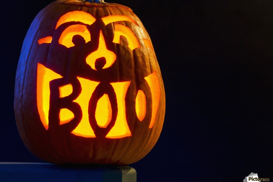 Carved Pumpkin Glowing With The Word Boo Carved In Mouth Calgary Alberta Canada Pacificstock