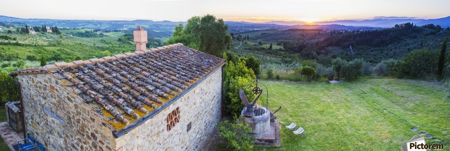 A stone house and a view of the lush landscape at sunset, Villa Capanuccia; Florence, Italy  Print