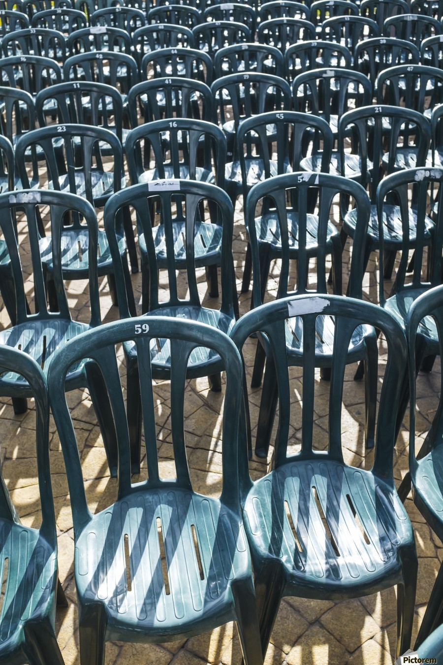 Plastic green chairs lined up in rows; Malaga Province, Andalusia, Spain  Print