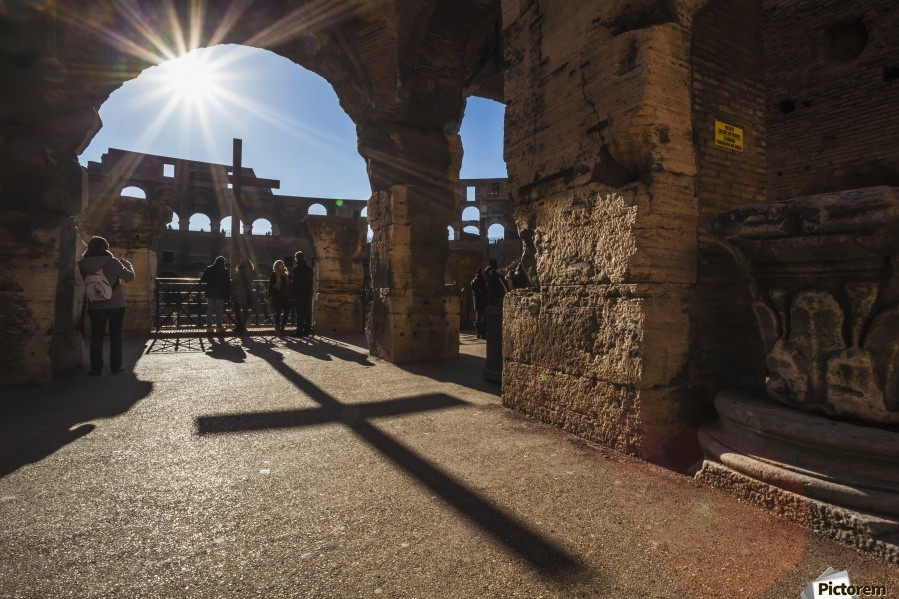Sunburst through an archway at the Colosseum and a shadow of a cross; Rome, Italy  Print