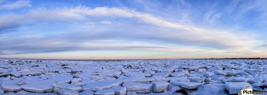 Ice forms on the shores of Hudson Bay as sunset starts to light up the clouds; Churchill, Manitoba, Canada  Print