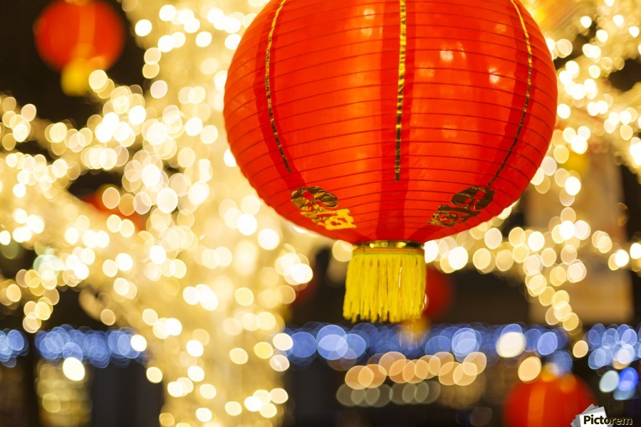 red and gold chinese lantern with sparkling white lights in the