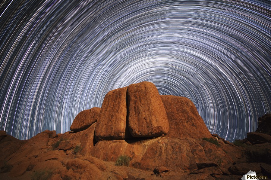 Star trails above a large boulder in Richtersveld National Park; South Africa  Print