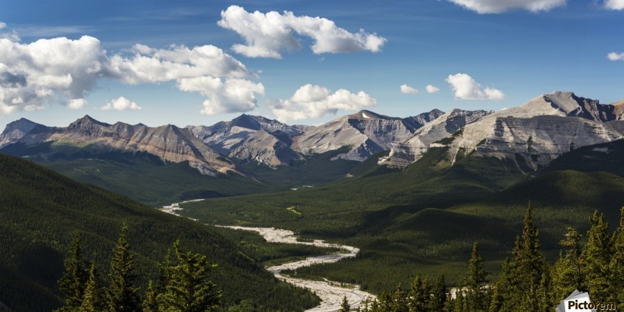 Panorama of river valley and mountain range with blue sky and clouds; Bragg Creek, Alberta, Canada  Print