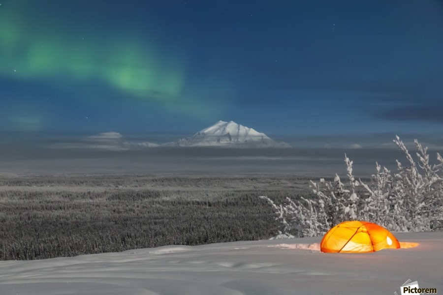 Green Aurora Borealis shines above moonlight casting light on Mount Drum and the Copper River Valley, a glowing tent on a foggy winter night, Copper River Valley, South-central Alaska; Alaska, United States of America  Print
