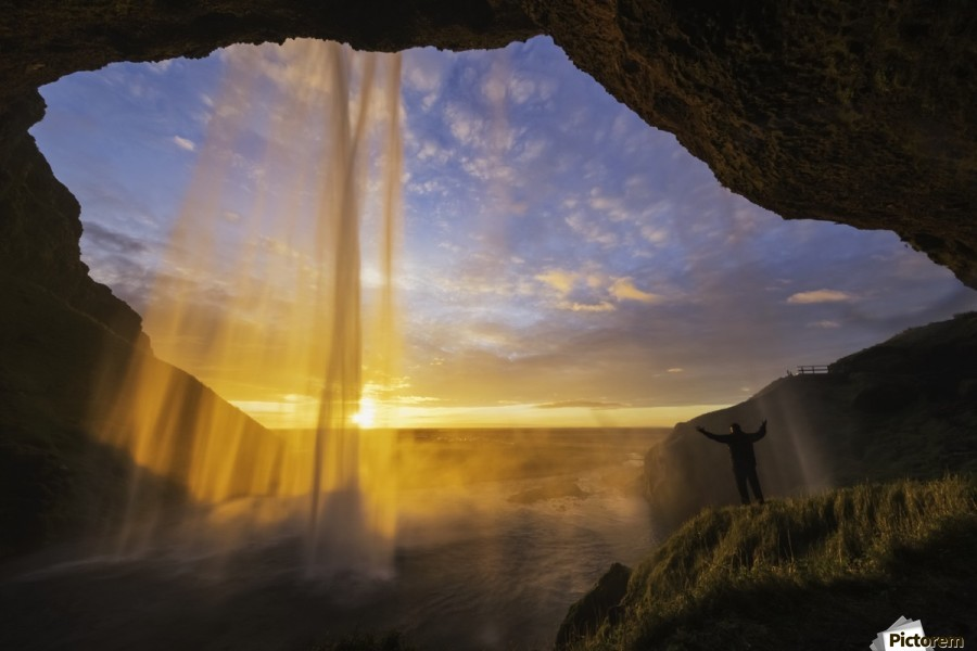 Man standing behind the waterfall known as Seljandafoss along the southern coast of Iceland; Iceland  Print