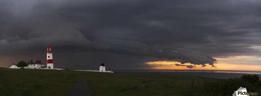 Souter Lighthouse under ominous storm clouds; South Shields, Tyne and Wear, England  Print
