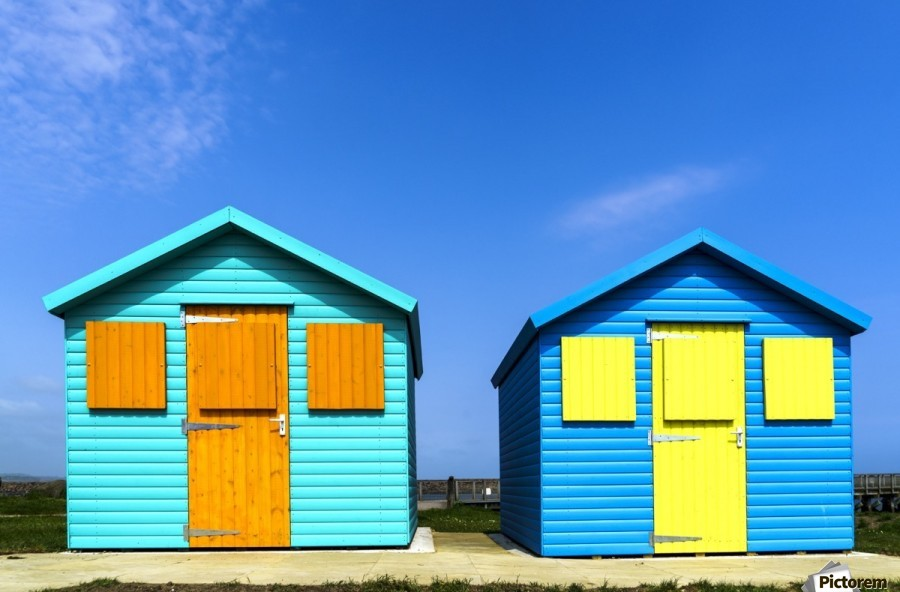 Two Colourful Buildings Side By With Boarded Up Windows Amble