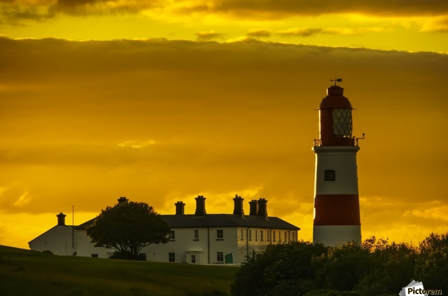 Souter Lighthouse under a glowing golden sky at sunset; South Shields, Tyne and Wear, England  Print