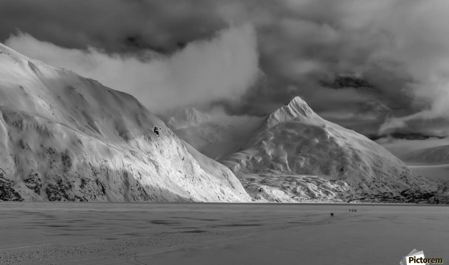 Hikers make the trek to Portage Glacier on Portage Lake in winter, South-central Alaska; Alaska, United States of America  Print
