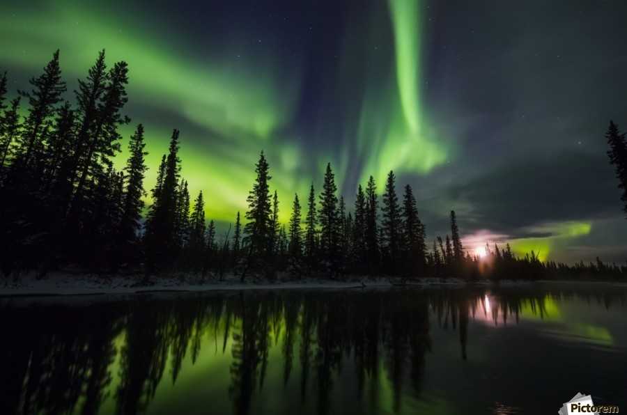 The aurora and rising moon reflect in the Clearwater River in Delta Junction; Alaska, United States of America  Print