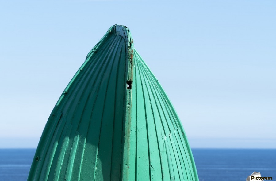 Close-up of  the bottom of the bow of a wooden boat painted green and the tranquil water and blue sky in the background; South Shields, Tyne and Wear, England  Print