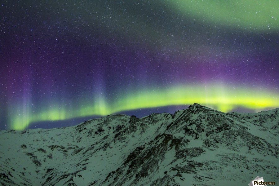Aurora borealis over mountains within Denali National Park on a very cold winter night.  The Andromeda Galaxy is visible to the left; Alaska, United States of America  Print