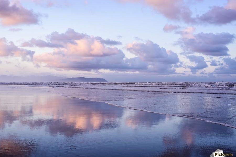 Clouds reflect on an Oregon beach at sunrise; Hammond, Oregon, United States of America  Print