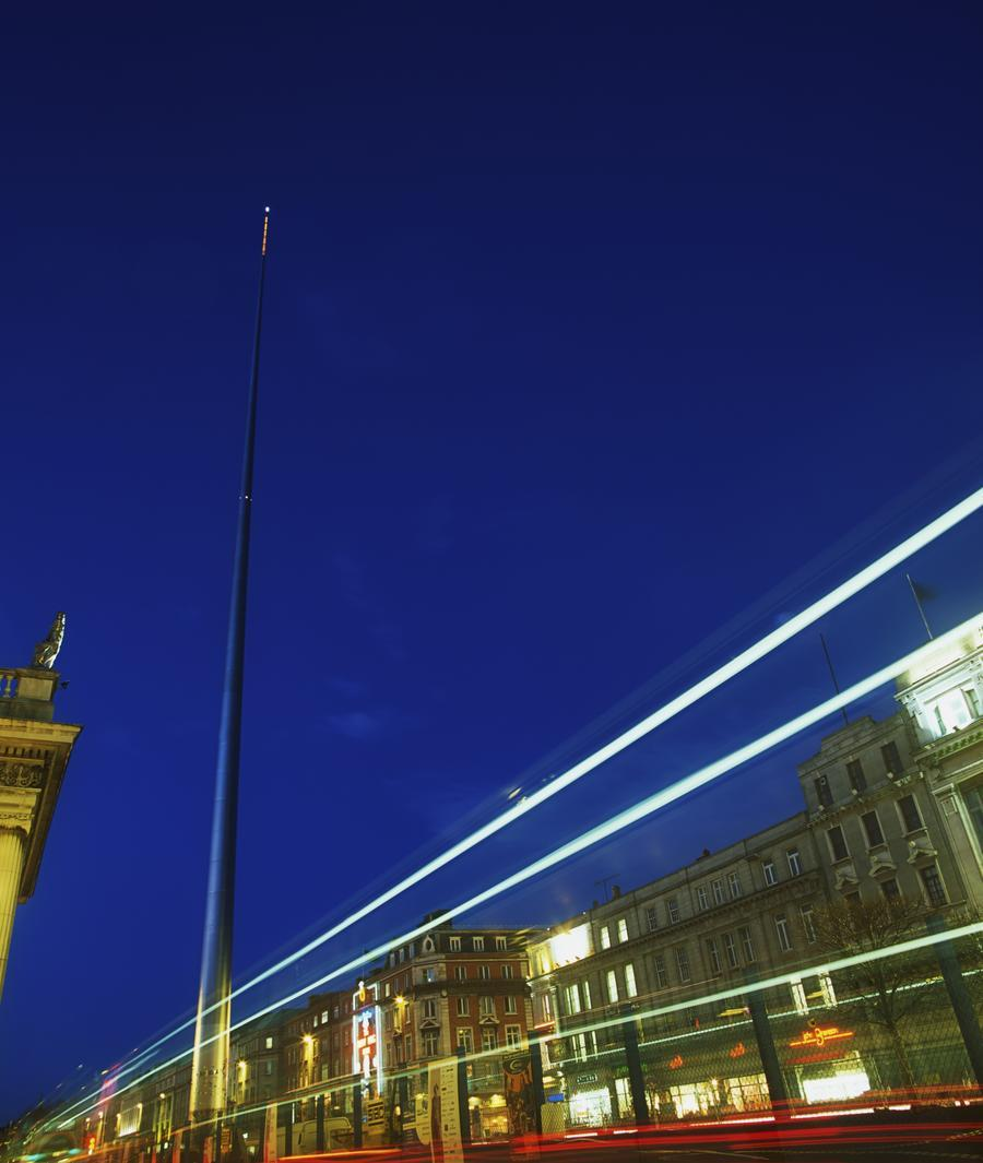 Spire Of Dublin, O'connell Street, Dublin, Ireland; Sculpture Against Traffic Light Streams  Print