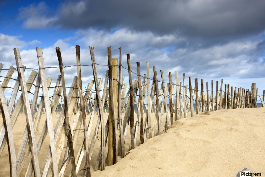 South Shields, Tyne And Wear, England; Dark Clouds Over Fence On A Beach  Print
