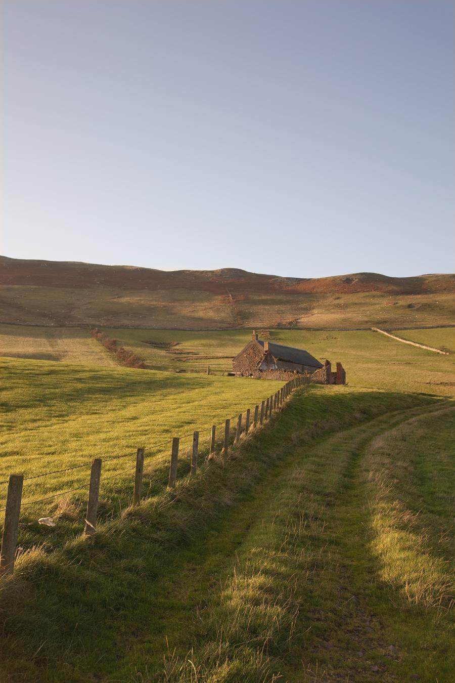 Northumberland, England; A Farm Structure And A Fence Around A Field  Print