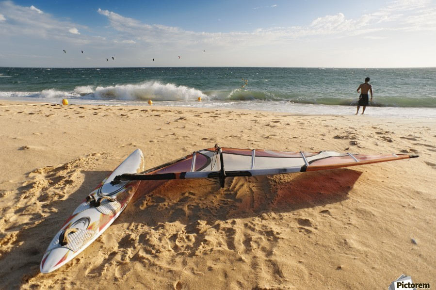 A Man On The Beach With His Windsurfing Board; Tarifa, Cadiz, Andalusia, Spain  Print