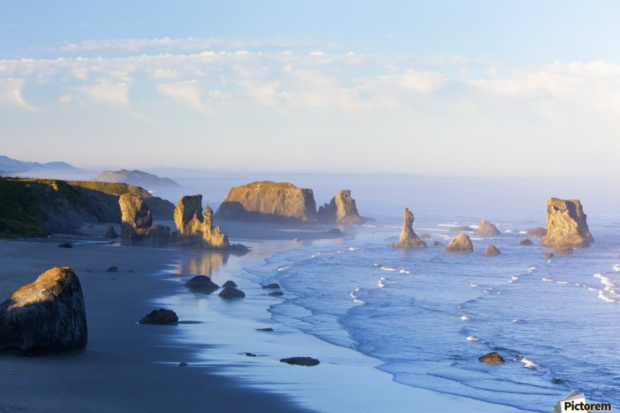 Morning Light Adds Beauty To Fog Covered Rock Formations At Bandon State Park; Bandon, Oregon, United States of America  Print