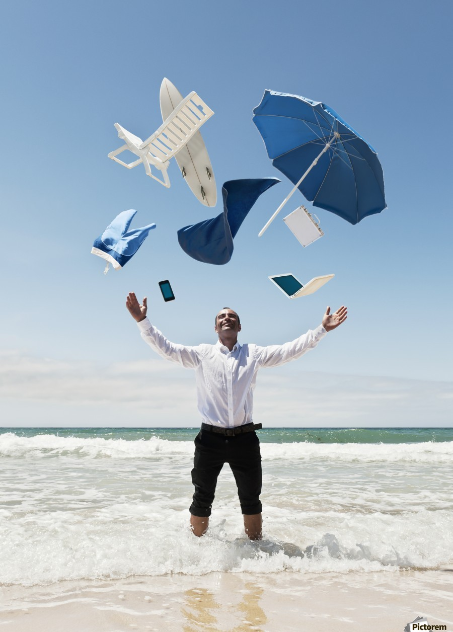 A Man Stands In The Ocean With Items From Work And Vacation Flying Over His Head; Tarifa, Cadiz, Andalusia, Spain  Print