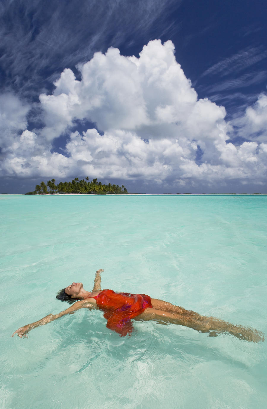 French Polynesia, Woman Floating In Ocean Water.  Print