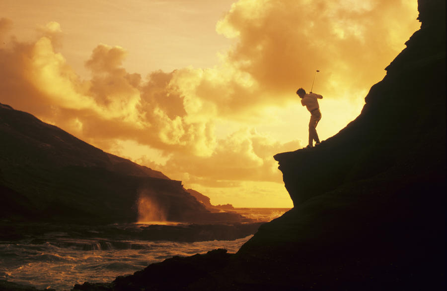 Hawaii, Golfer Standing On A Cliff And Swinging A Golf Club.  Print