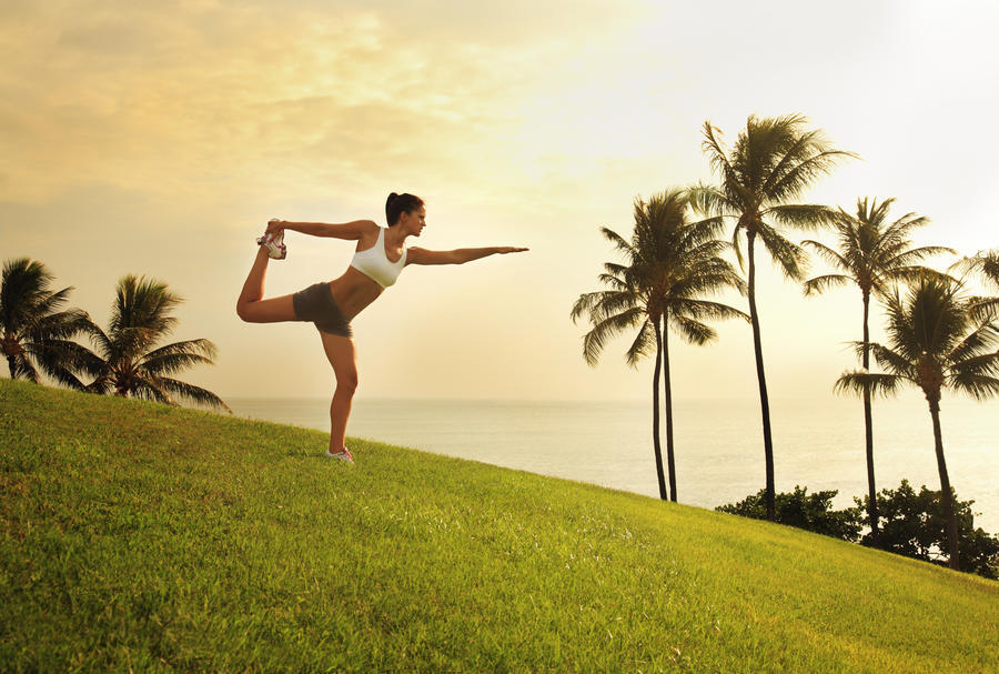 Hawaii, Oahu, Female Doing A Yoga Pose, Stretching On A Hill Overlooking Ocean, Palm Trees And Sunset.  Print