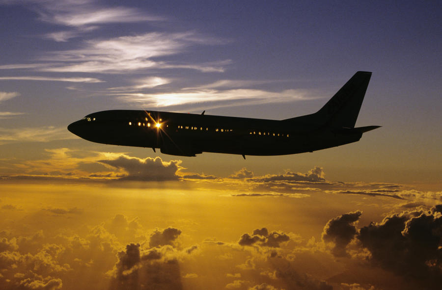 USA, Silhouette of airplane in sunset sky; Hawaii