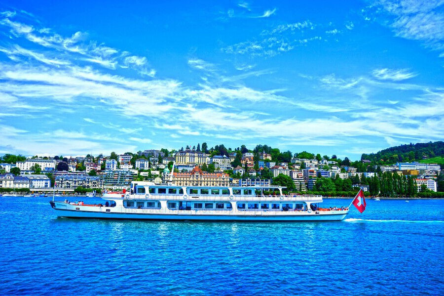 Cruise Boat On Lake Lucerne with City in Background in Switzerland  Print