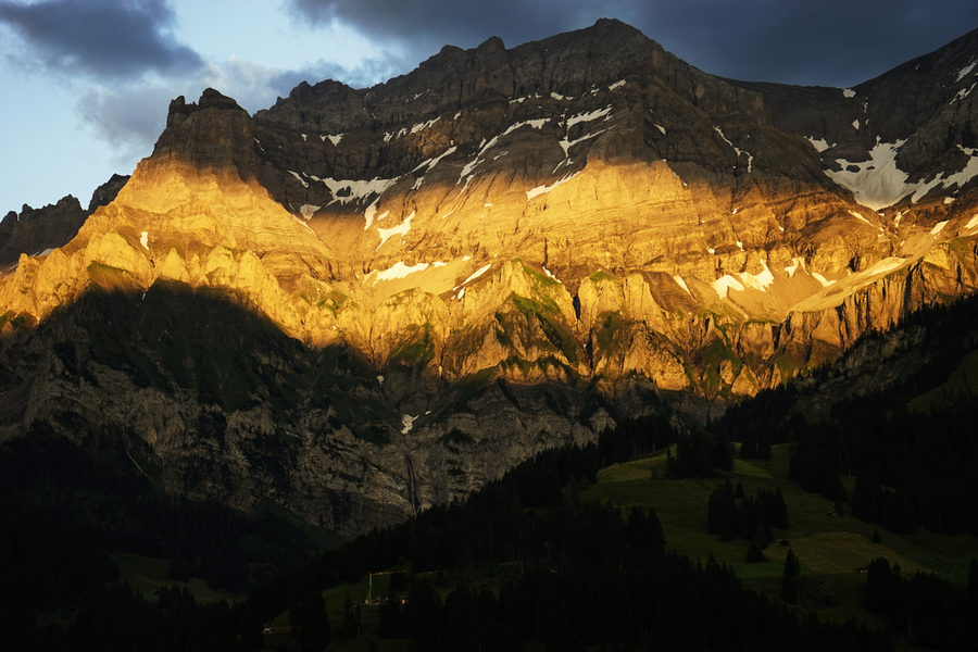 Mountain Bathed in the Golden Rays of the Sun at Sunset in Switzerland 2 of 3  Print