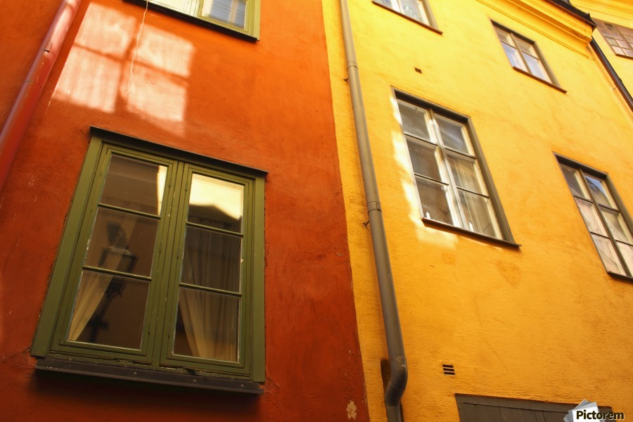 Low Angle View Of Red And Yellow Painted Buildings; Stockholm, Sweden  Print