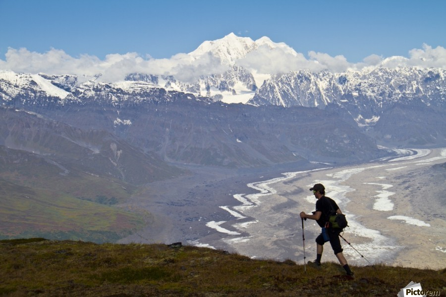 Silhouette Of A Man Hiking In The Tokosha Mountains Above The Tokositna Glacier With Mt. Hunter And The Alaska Range In The Background, Denali National Park & Preserve, Interior Alaska, Summer  Print