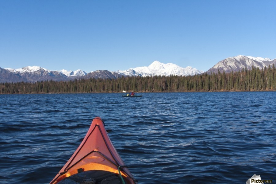 woman kayaking in byers lake as seen from another kayaker s point of