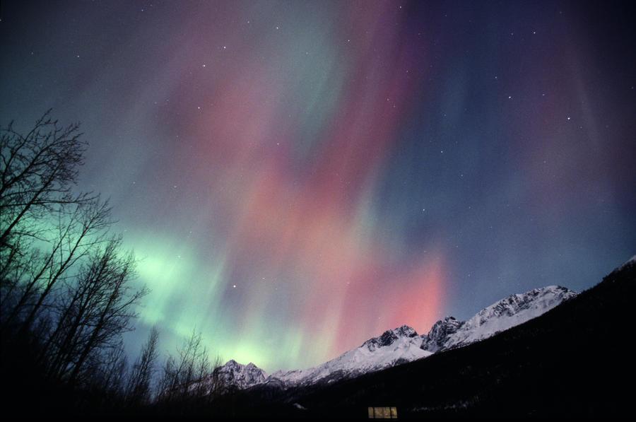 multi colored northern lights aurora borealis fill the night sky