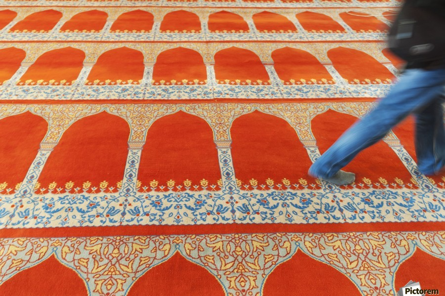A person walking over the colourful carpet in the suleymaniye mosque;Istanbul turkey  Print