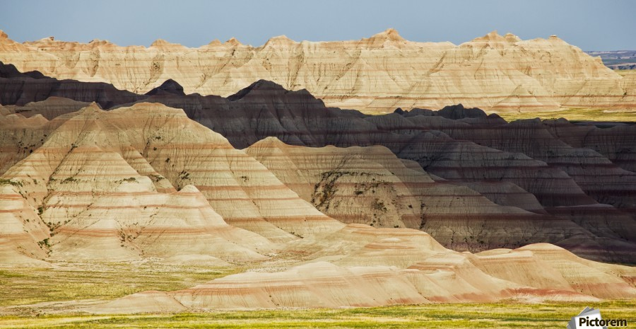 Light and shadows paint the landscape of badlands national park; south dakota united states of america  Print