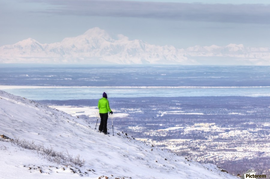 Woman snowshoer taking in the view of Mt. McKinley (Denali) from Blueberry Hill at the Glen Alps area of Chugach State Park, Anchorage, Southcentral Alaska, Winter, HDR  Print