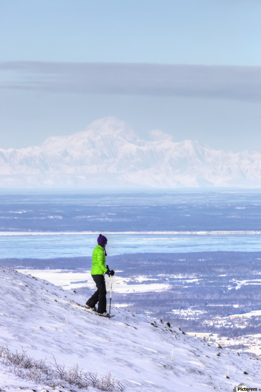 Woman snowshoeing on Blueberry Hill at the Glen Alps area of Chugach State Park with Mt. McKinley (Denali) in the background, Anchorage, Southcentral Alaska, Winter, HDR  Print