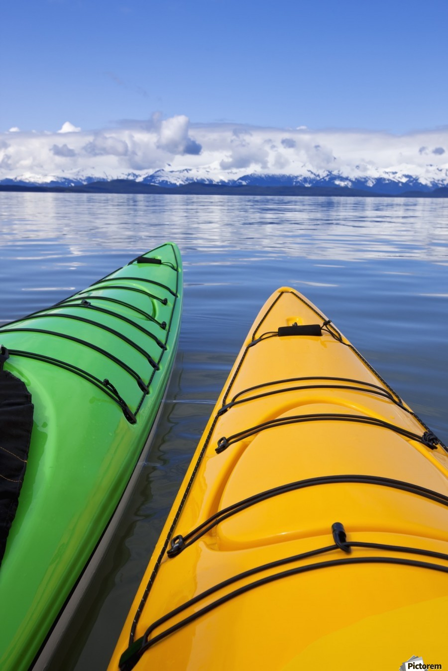 Kayakers enjoy a tranquil morning paddle in Lynn Canal, Alaska, near Juneau. Chilkat Mountains beyond.  Print