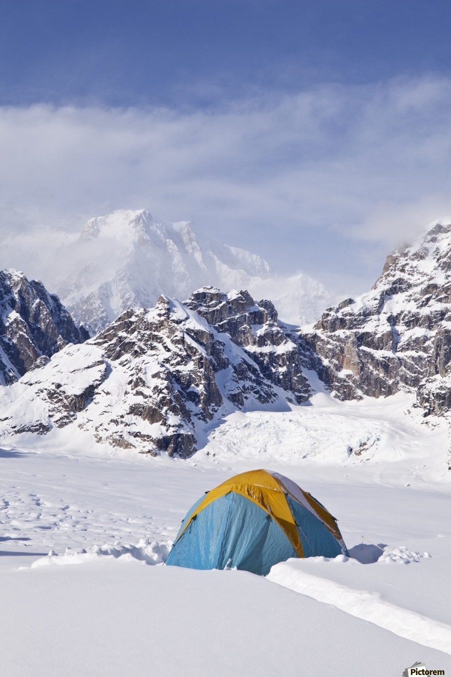 Mountain tent on ridge in winter, Mt. McKinley in background, part of Mt. Dan Beard immediately behind tent, Denali National Park and Preserve; Alaska, United States of America  Print