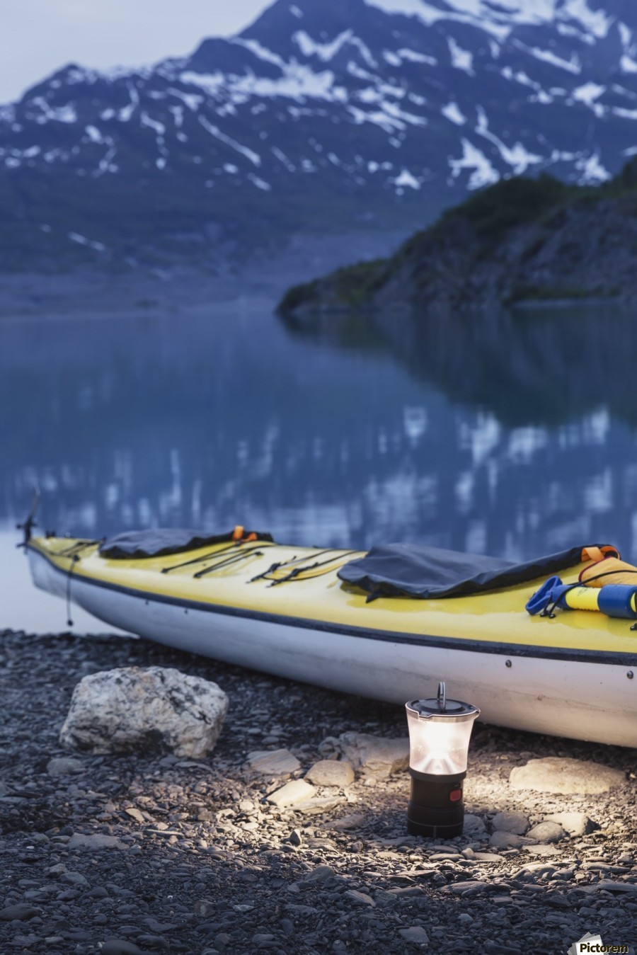 Kayak and lantern on the beach with mountains in the back ground at dusk, Shoup Bay State Marine Park, Prince William Sound, Valdez, Southcentral Alaska  Print