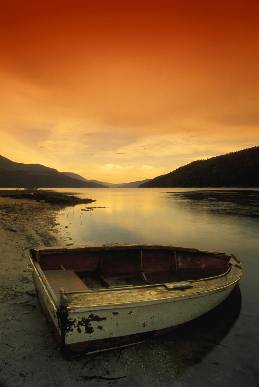 Old Rowboat At Water's Edge With Sunset Background  Print