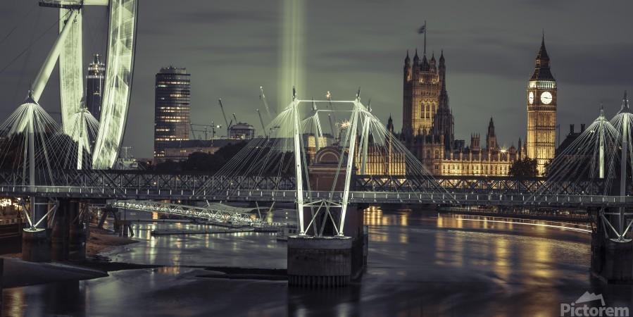 Night view of the London Eye, Golden Jubilee bridge and Westminster, London, UK  Print