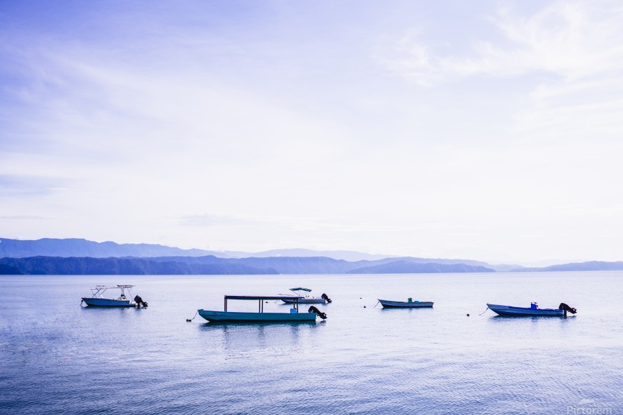 Sunrise in the Osa peninsula with boats in harbour  Print