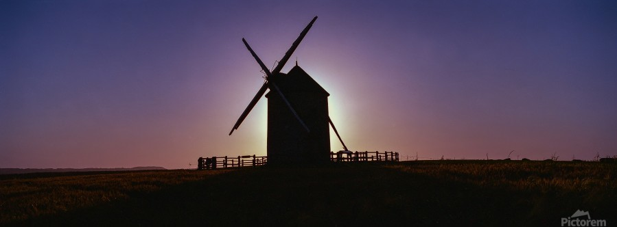 Windmill against the sunset north west France.  Print