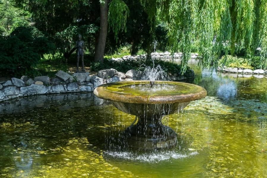 Refreshing Summer - the Little Fisherman Fountain Cheerfully Splashing in the Sunshine  Print