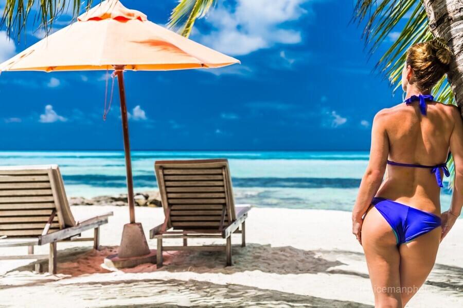 woman in bikini under palm on sea background  Print