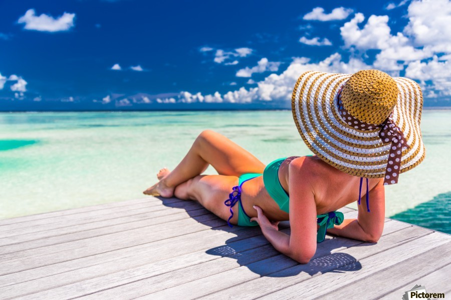 Woman In Bikini Lying On Tropical Beach At Maldives