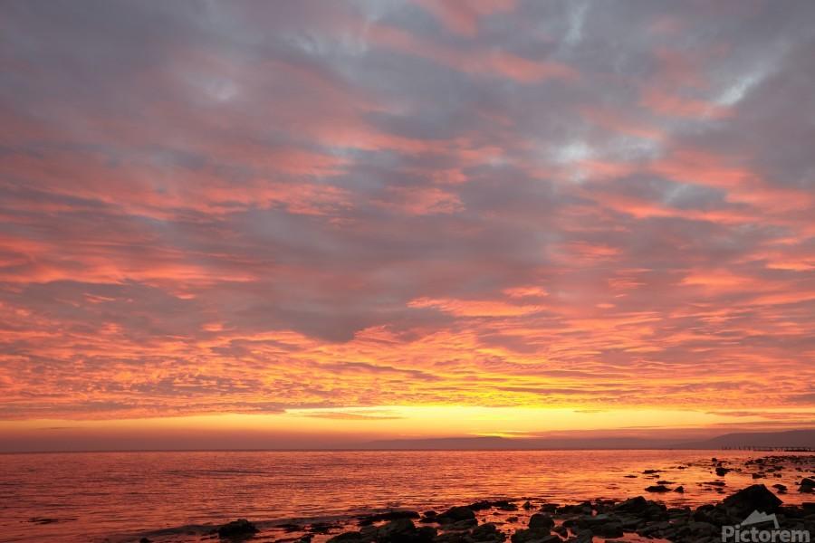 Dramatic sunset at a small bay  Print