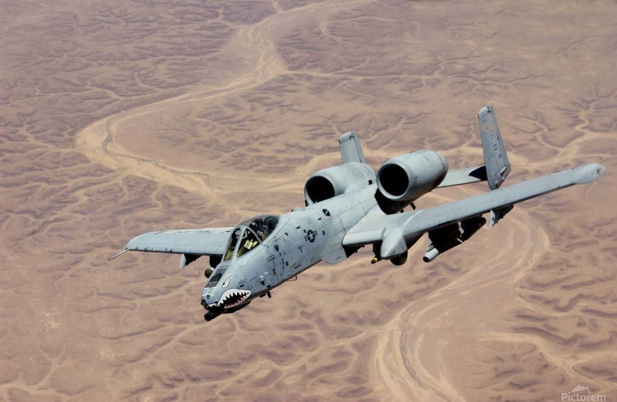 An A-10 Thunderbolt soars above the skies of Iraq.  Print